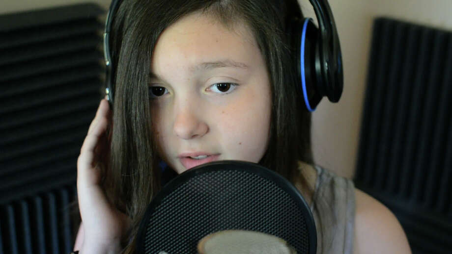 Taylor Felt, 11, performs Believe for her music video. Photo: Contributed
