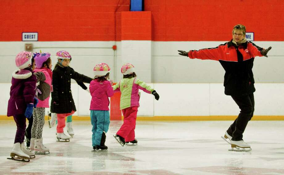 Danbury Arena ice skating instructor Amy Nargiso leads a group of skill level 3 skaters, teaching balance and technique. Wednesday, Jan. 2, 2013 Photo: Scott Mullin / The News-Times Freelance
