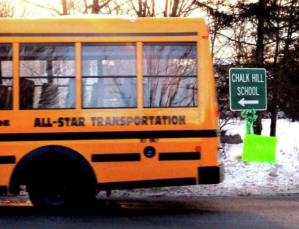 "A school bus drives from Pepper Street towards the former Chalk Hill School on Jockey Hollow Road in Monroe Thursday, January 3, 2013. A handwritten sign says ""Welcome We love you"" as Sandy Hook Elementary School students of Newtown go to their first day of classes in a temporary school after the shootings December 14, 2012 at their school in Newtown. Photo: Photo By Peter Hvizdak / New Hav / The News-Times"