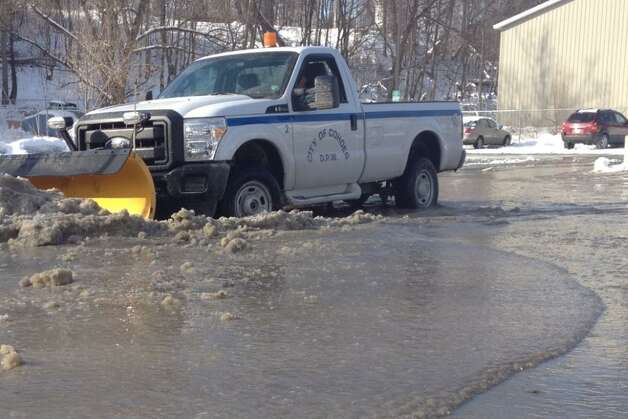 Cohoes officials are dealing with a ruptured water pipe at the Roulier Heights apartment near Garner Street. (John Carl D'Annibale / Times Union)