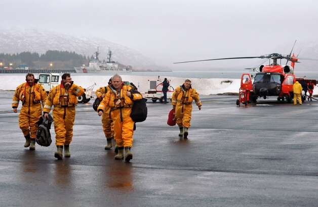 Eighteen crew members of the mobile drilling unit Kulluk arrive at Air Station Kodiak after being airlifted by a Coast Guard helicopter from a vessel 80 miles southwest of Kodiak, Alaska on Saturday, Dec. 29, 2012. Photo: Petty Officer 3rd Class Jonathan