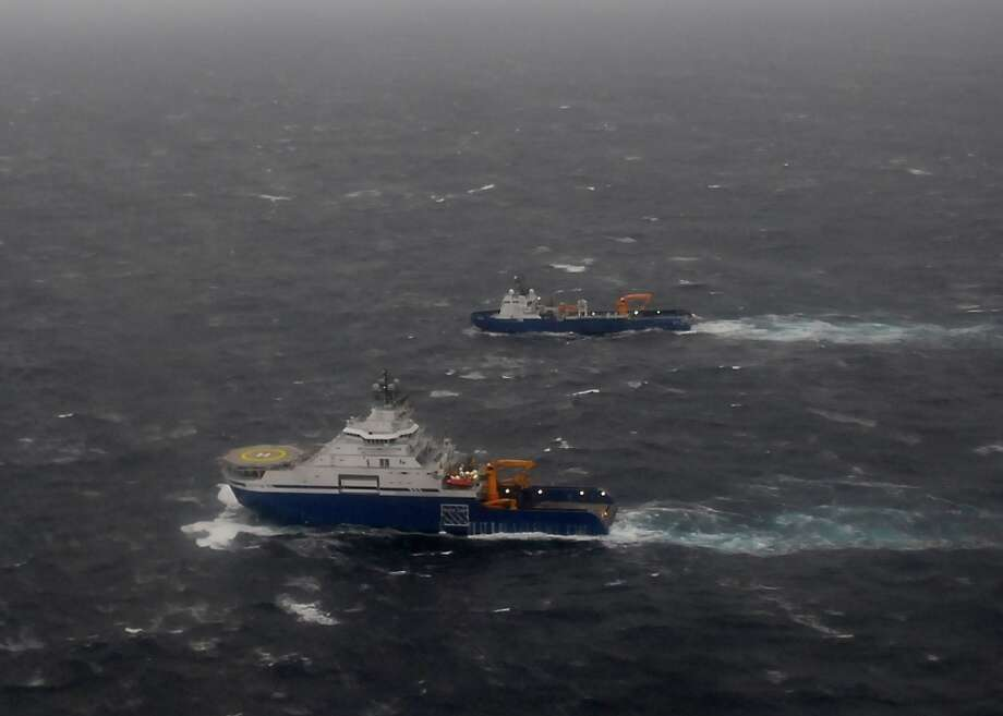 The tugs Aiviq and Nanuq tow tandem tow the mobile driling unit Kulluk 116 miles southwest of Kodiak City, Alaska. The tugs were attempting to tow the Kulluk to a sheltered area but weather conditions, including 29 mph winds and 20-foot seas, have deterred them.