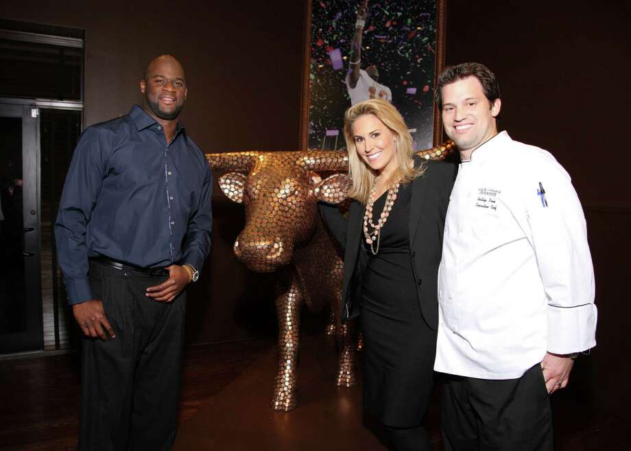 Vince Young, with partners Laura McIngvale Brown and her husband, executive chef Phillip Brown, opened the Vince Young Steakhouse in Austin in 2010. Photo: Paul Ladd, AP / handout