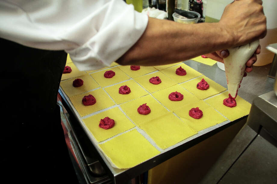 Ravioli with roasted sweet potato, beets, goat cheese, and roasted garlic being made. Photo: John Storey, Special To The Chronicle / John Storey