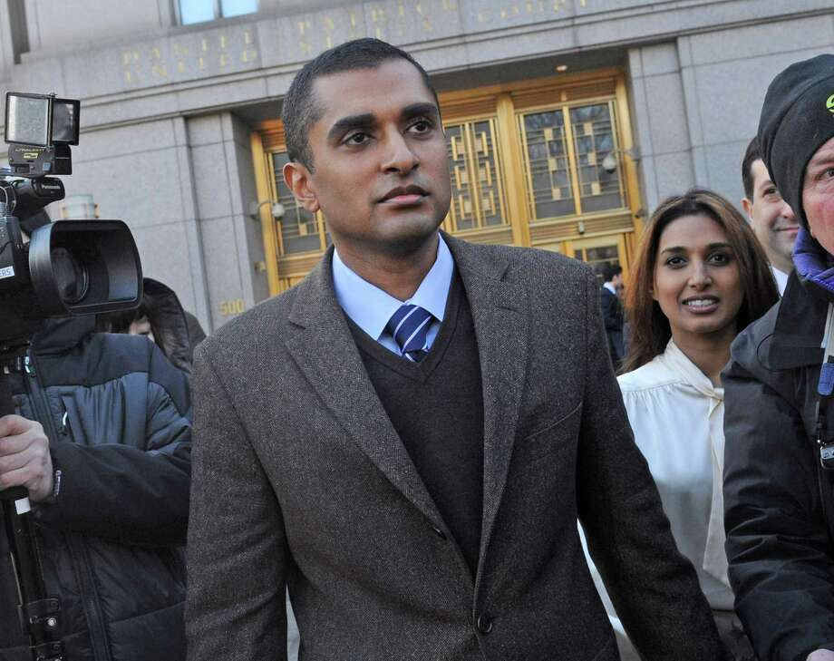 Mathew Martoma, center, former SAC Capital Advisors hedge fund portfolio manager exits Manhattan federal court  with his wife Rosemary, right, Thursday, Jan. 3, 2013, in New York. Authorities say Martoma persuaded a medical professor to leak secret data from an Alzheimer's disease drug trial. Investigators say it helped him earn more than a quarter-billion dollars in illegal profits. (AP Photo/Louis Lanzano) Photo: Louis Lanzano, Associated Press / Associated Press