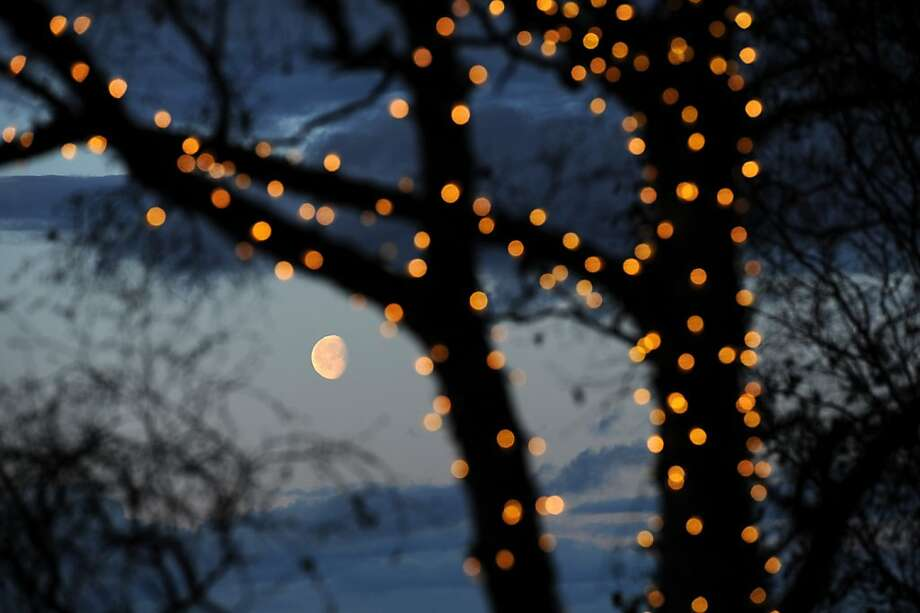 It's two days after New Year's:Time to take the Christmas lights down, people of Anchorage, Alaska. Photo: Erik Hill, Associated Press