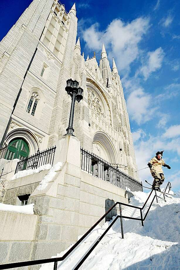 Please pray for him: Sixteen-year-old Alex Hackel skis the handrail of the Basilica of Saints Peter and Paul stairs in Lewiston, Maine. Photo: Daryn Slover, Associated Press