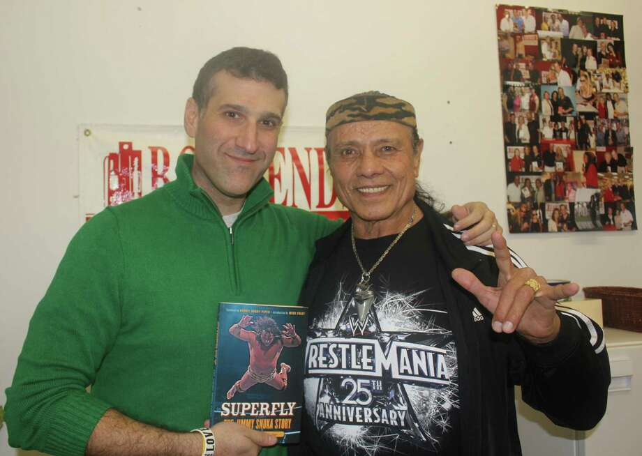 "Love ya, brudda: Jon Chattman, of Westchester, N.Y., and WWE Hall of Famer Superfly Jimmy Snuka will be on hand to discuss their book, ""Superfly: The Jimmy Snuka Story,"" at the Barnes & Noble in Stamford on Saturday, Jan. 12. Photo: Contributed Photo"
