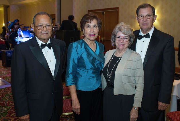 Paricutin Civic and Educational Foundation New Year's Eve Gala: Educational  chairman Ray Gonzalez (from left) and his wife, Delia Gonzalez, get  together with guests Sylvia and Art Muñoz during the gala.