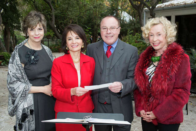 San Antonio Gardenia and Musical Club Christmas Luncheon: Past  president Caro Canales (from left) and scholarship chairwoman Tenchita  Flores join UTSA director of choral activities John Silantien and past  president DeeAnn Simpson during the luncheon at Club Giraud.