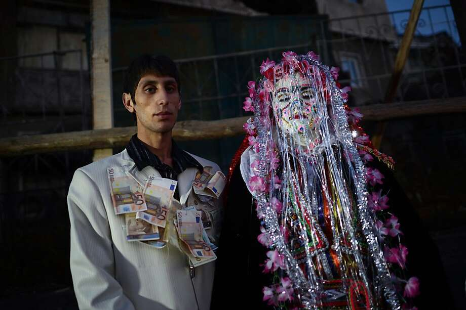 Marrying into money: Pomak Muslims Djamal Sirakov and Fatme Ulanova are wed in the Bulgarian village of Ribnovo. Pomak weddings are known for their liberal use of makeup and banknotes. Photo: Dimitar Dilkoff, AFP/Getty Images