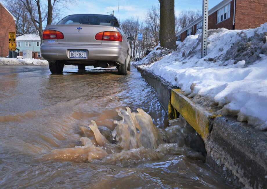 Water from a ruptured water pipe floods the streets at the Roulier Heights Apartments in Cohoes Thursday Jan. 3, 2013.  (John Carl D'Annibale / Times Union) Photo: John Carl D'Annibale / 00020650A