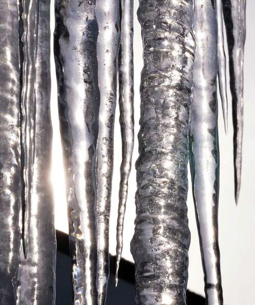 Sunlight shines through icicles on New Scotland Avenue in Albany  Thursday Jan. 3, 2013.  (John Carl