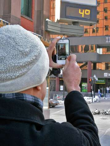 Al Martinez of Albany uses his cell phone to record temperature display on a bank sign at Pearl and State Streets in Albany Thursday Jan. 3, 2013.  (John Carl D'Annibale / Times Union) Photo: John Carl D'Annibale / 00020650A