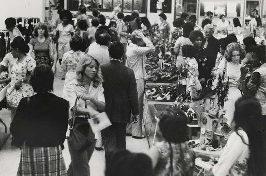 Shoppers crowd the downtown Foley's in 1976. In the '70s, such department stores were one-stop destinations, where people of all ages bought clothes, furniture and home electronics. (Blair Pittman / Houston Chronicle file)