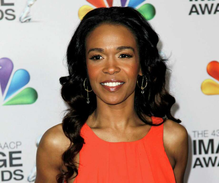 "FILE - This Feb. 17, 2012 file photo shows singer-actress Michelle Williams at the 43rd NAACP Image Awards in Los Angeles. Williams is joining the latest national tour of the musical ""Fela!"" Producers said Thursday, Jan. 3, 2013, the singer who starred on the UPN sitcom ""Half & Half"" will be onstage when the tour opens at Sidney Harman Hall in Washington, D.C., on Jan. 29.  Williams, part of Destiny's Child along with Kelly Rowland and Beyonce, is now solo artist who released the dance album ""Unexpected"" and the single ""On The Run."" (AP Photo/Matt Sayles, file) Photo: Matt Sayles"