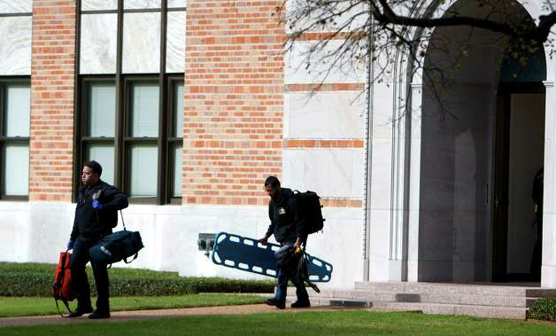 Firefighters leave Rice University's Rayzor Hall after rescuing a man trapped,Thursday, Jan. 3, 2013, in Houston. An electrician fell and became trapped between two air ducts. He called 911 from his cell phone. Firefighters responded and cut through drywall and tin to free him. Photo: Cody Duty, Houston Chronicle / © 2012 Houston Chronicle