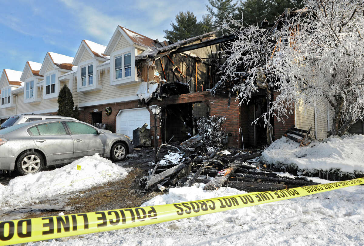 The scene at a townhouse on Chaucer Place where a fire took place early Thursday morning Jan. 3, 2013 in Guilderland, N.Y. (Lori Van Buren / Times Union)