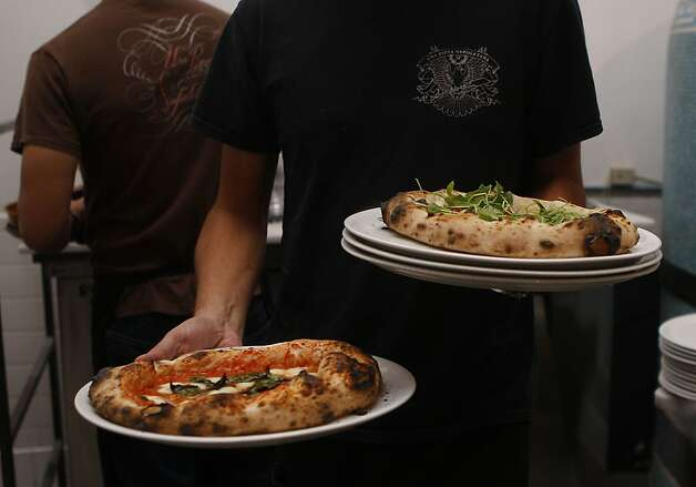 Pizzas at Una Pizza Napoletana during dinner time. Photo: Liz Hafalia, The Chronicle