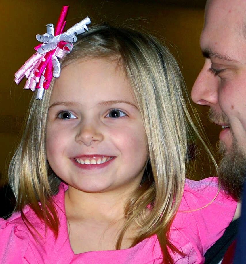 Skylin Johnson, 5, beams as she and her father, Bill, head to the dance floor during the annual Sweetheart Dance, hosted at New Milford High School by New Milford Girl Scout troops 40225 and 40220. Photo: Deborah Rose