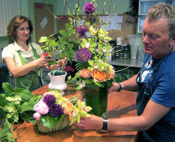 Floral designer Craig Hapler creates an arrangement for a wedding at Ruth Chase Flowers, assisted by shop owner Luisa Amaral. The New Milford business flourishes from its new home on Church Street during 2012. Photo: Norm Cummings