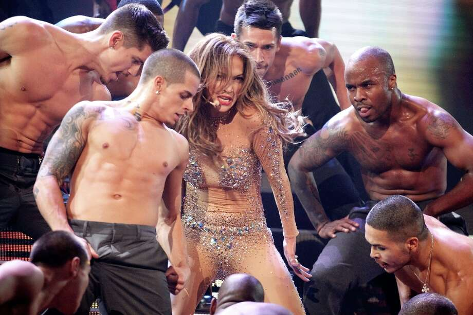 At 43, Jennifer Lopez isn't old-old, but she's a lot older than dancer boyfriend Casper Smart, who's 25 (left, middle row). They're pictured on stage in 2011. Photo: Christopher Polk/AMA2011, Getty Images For AMA / 2011 Getty Images