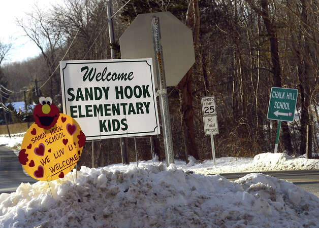 "A sign welcoming children from Sandy Hook Elementary school sits on the road in Monroe, Connecticut on January 3, 2013.  Students at the elementary school where a gunman massacred 26 children and teachers last month were returning Thursday to classes at an alternative campus described by police as ""the safest school in America."" Survivors were finally to start their new academic year in the nearby town of Monroe, where a disused middle school has been converted and renamed from its original Chalk Hill to Sandy Hook. Photo: TIMOTHY A. CLARY, AFP/Getty Images / 2013 AFP"