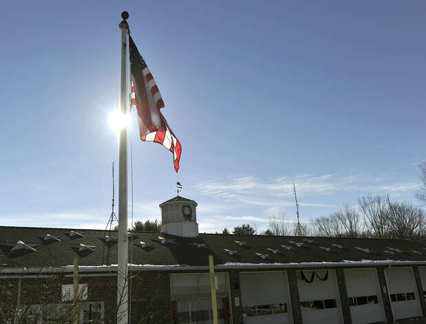 "A flag outside the  Sandy Hook Fire department in Newtown, Connecticut on January 3, 2013.  Students at the elementary school where a gunman massacred 26 children and teachers last month were returning Thursday to classes at an alternative campus described by police as ""the safest school in America."" Survivors were finally to start their new academic year in the nearby town of Monroe, where a disused middle school has been converted and renamed from its original Chalk Hill to Sandy Hook. Photo: TIMOTHY A. CLARY, AFP/Getty Images / 2013 AFP"