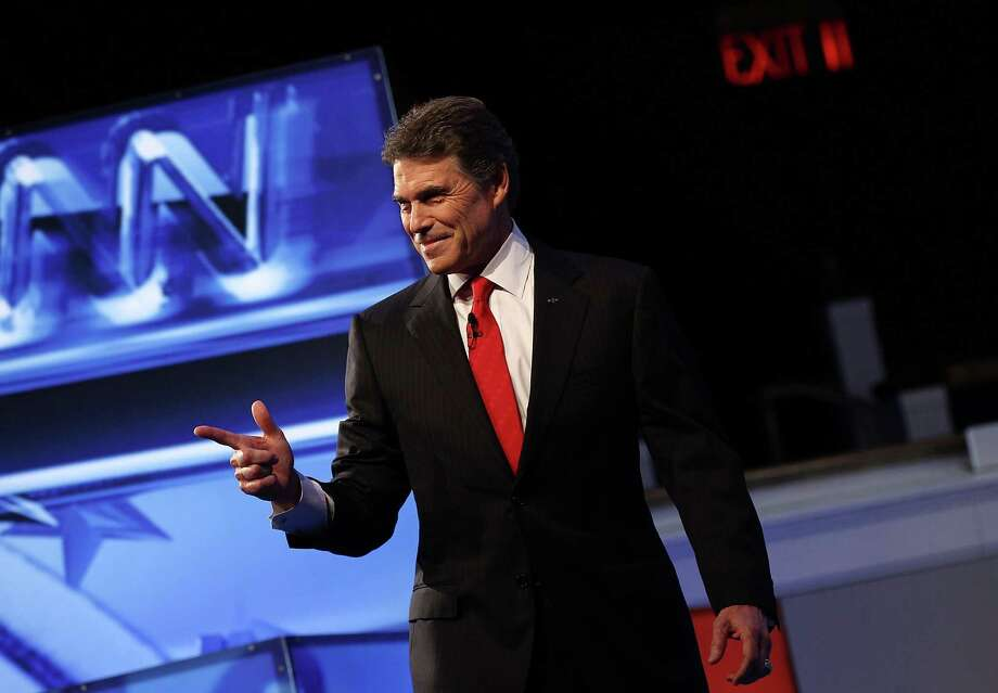 Texas Gov. Rick Perry is introduced prior to a debate at Constitution Hall November 22, 2011 in Washington, DC. Photo: Win McNamee, Getty / 2011 Getty Images