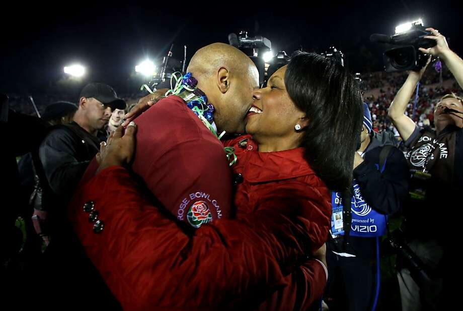 Former Secretary of State and Stanford alumna Condoleezza Rice congratulates coach David Shaw after the Cardinal Rose Bowl win. Photo: Jeff Gross, Getty Images