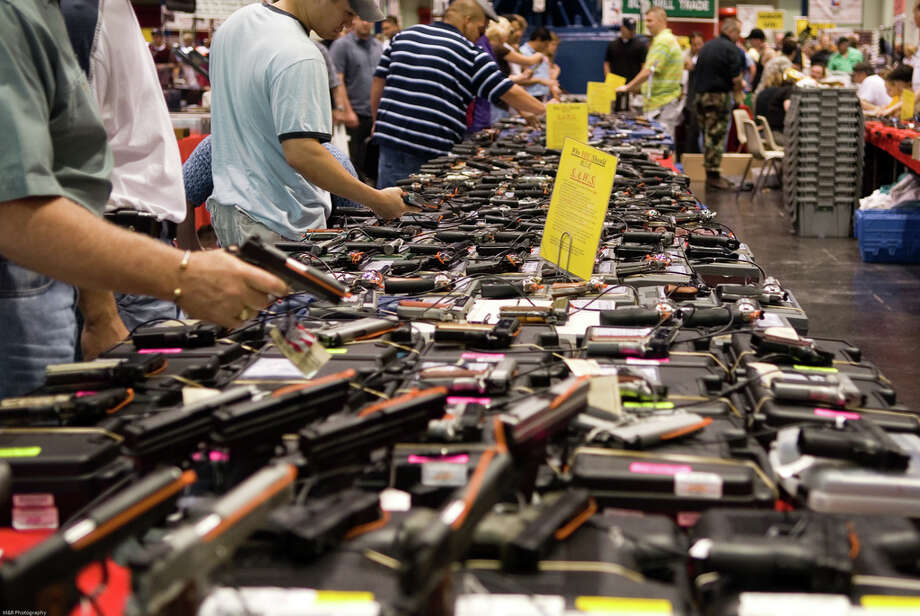Visitors check out arms at a gun show at Houston's George R. Brown Convention Center. Photo credit: M.Glasgow/Flickr Photo: M Glasgow/Flickr