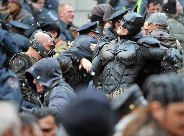 "Bane   fighting  Batman (Christian Bale) Filming of the Batman movie ""The Dark Knight Rises"" at  Wall Street & Williams St NYC Photo: RICHARD CORKERY / New York Daily News"