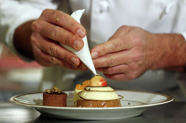Beverly Hilton executive pastry chef Thomas Henzi prepares the dessert course during the menu preview for the 70th annual Golden Globe awards at the Beverly Hilton Hotel on Thursday, Jan. 3, 2013, in Beverly Hills, Calif. The Golden Globes will be held Sunday, Jan 13. Photo: Matt Sayles/Invision/AP