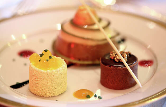 The dessert trio of cappuccino mousse dome, orange sanguine, and chocolate salted caramel. Photo: Matt Sayles/Invision/AP