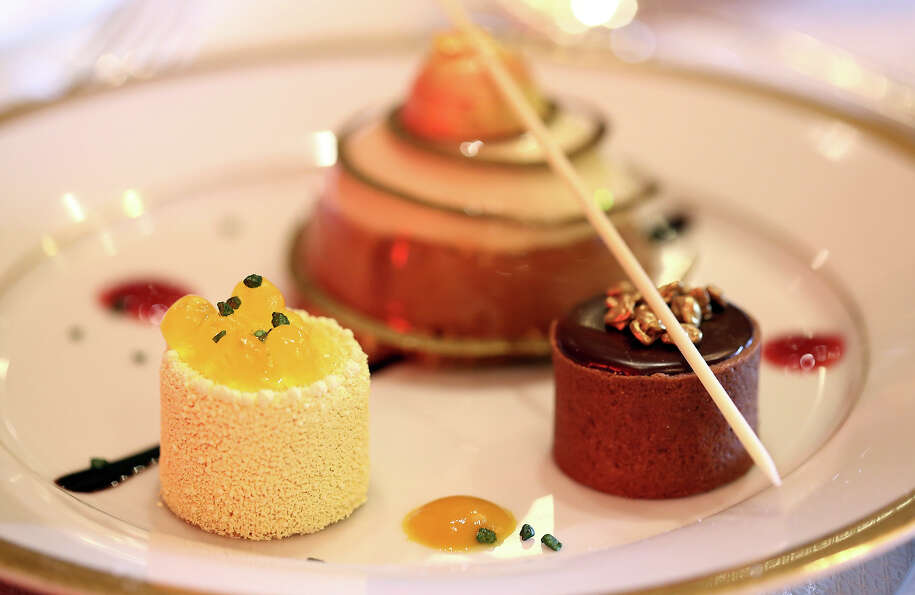 The dessert trio of cappuccino mousse dome, orange sanguine, and chocolate salted caramel.