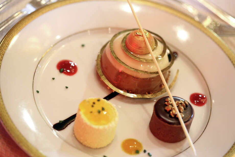 The dessert trio of cappuccino mousse dome, orange sanguine, and chocolate salted caramel is seen during the menu preview for the 70th annual Golden Globe awards at the Beverly Hilton Hotel on Thursday, Jan. 3, 2013, in Beverly Hills, Calif. The Golden Globes will be held Sunday, Jan 13. Photo: Matt Sayles/Invision/AP