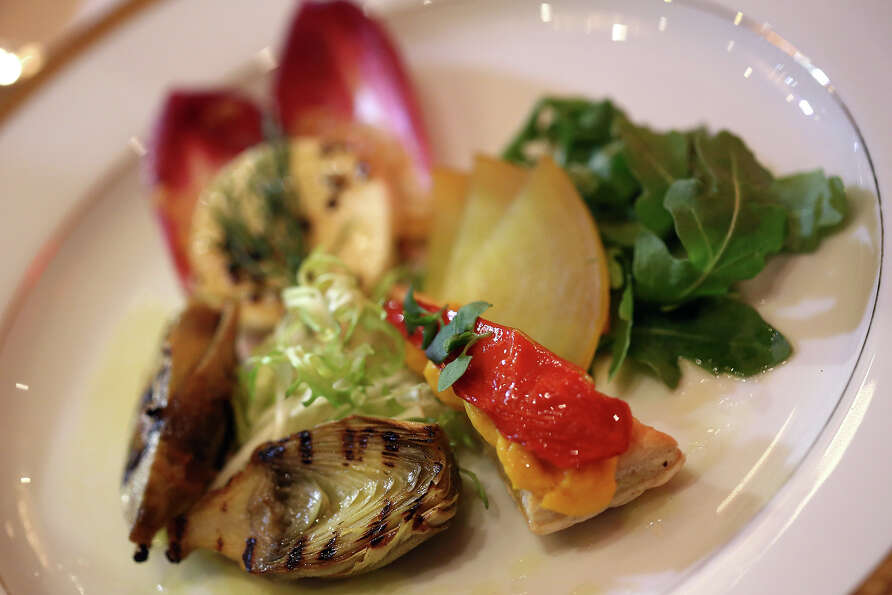 The appetizer dish is grilled artichoke with fennel tomato lemon mousse and California pepper honey