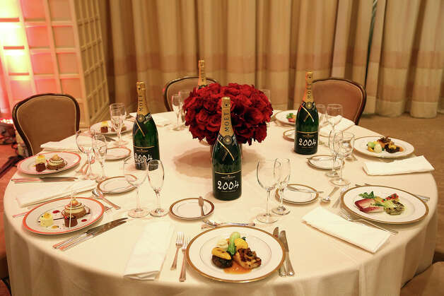 The table setting and dishes are seen during the menu preview on Thursday in Beverly Hills. Photo: Matt Sayles/Invision/AP