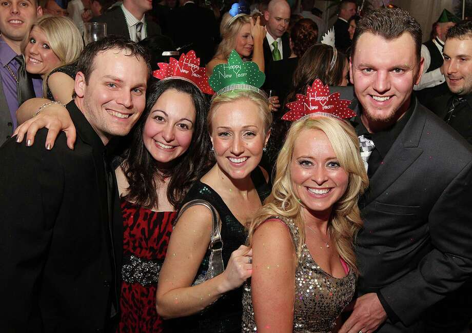 Troy, NY - December 31, 2012 - (Photo by Joe Putrock/Special to the Times Union) - (l to r) Michael and Jennifer Lieberman, Amanda O'Malley, and Amy and Josh Jewett during the 8th Annual Last Night New Year?s Eve Gala to benefit St. Peter?s Hospital Foundation. Photo: Joe Putrock / Joe Putrock
