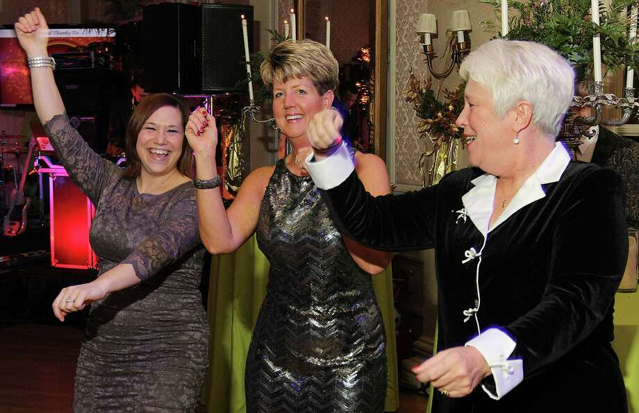 Troy, NY - December 31, 2012 - (Photo by Joe Putrock/Special to the Times Union) - Sarah Christ(left), Capital Cardiology Associates, P.C. Human Resources Manager Kelly Kaschinka(center) and Clinical Director Joanne McCarthy(right) take part in the Gangnam Style flash-mob during the 8th Annual Last Night New Year?s Eve Gala to benefit St. Peter?s Hospital Foundation. Photo: Joe Putrock