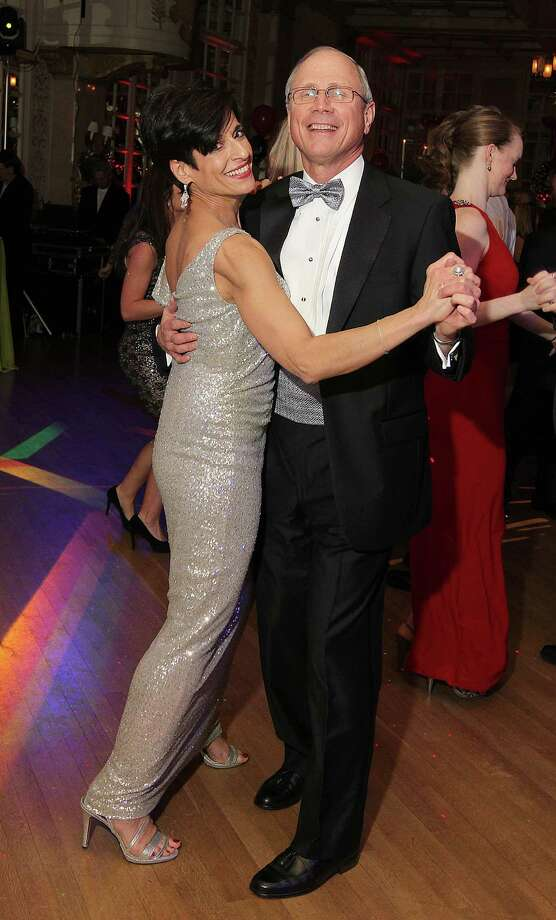 Troy, NY - December 31, 2012 - (Photo by Joe Putrock/Special to the Times Union) - St. Peter's Health Partners President and CEO James K. Reed, MD(right) and his wife, Risa(left), dance in the new year during the 8th Annual Last Night New Year?s Eve Gala to benefit St. Peter?s Hospital Foundation. Photo: Joe Putrock