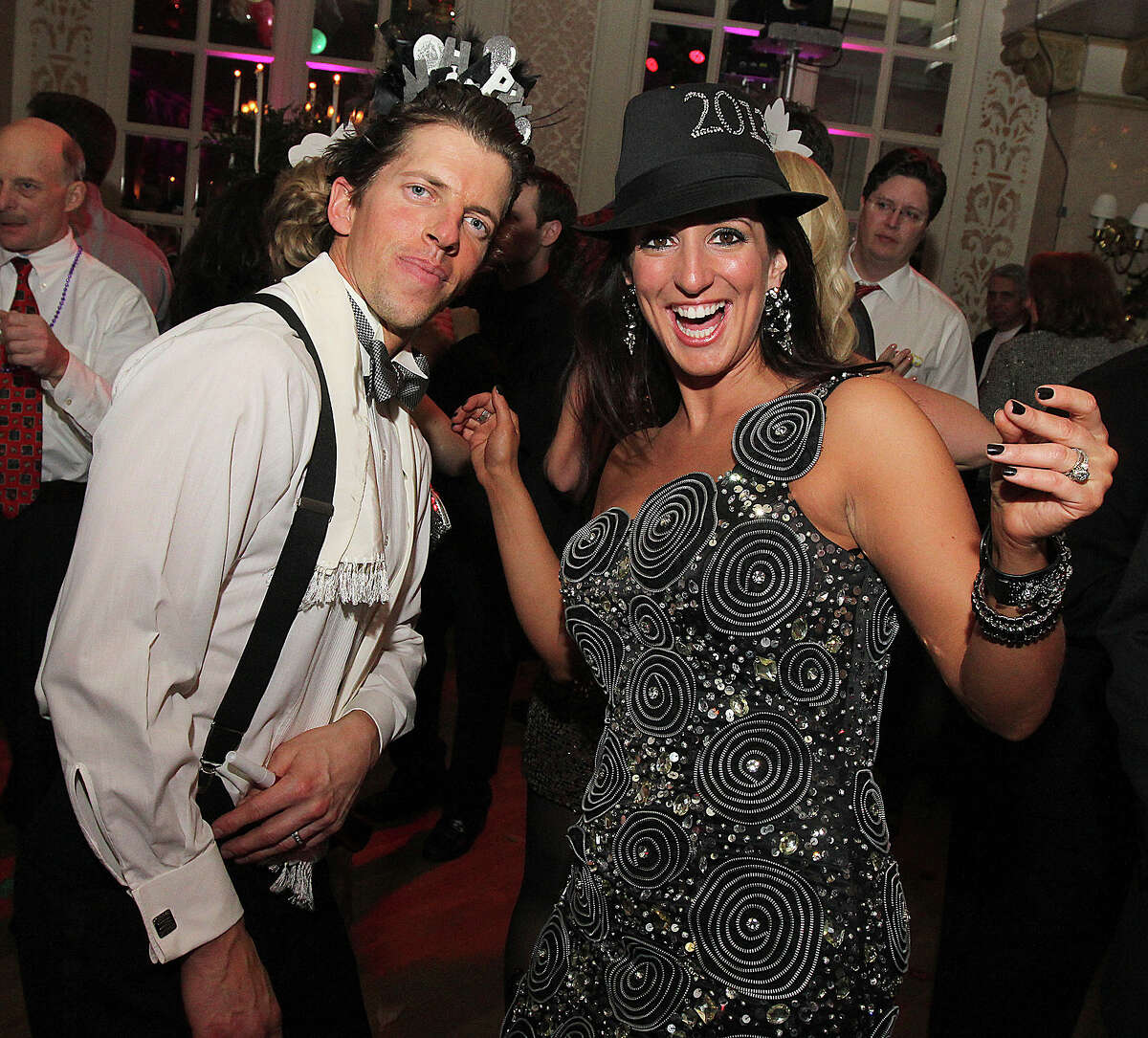 Troy, NY - December 31, 2012 - (Photo by Joe Putrock/Special to the Times Union) - Mark(left) and Tara(right) Burnham tear up the dance floor during the 8th Annual Last Night New Year?s Eve Gala to benefit St. Peter?s Hospital Foundation.