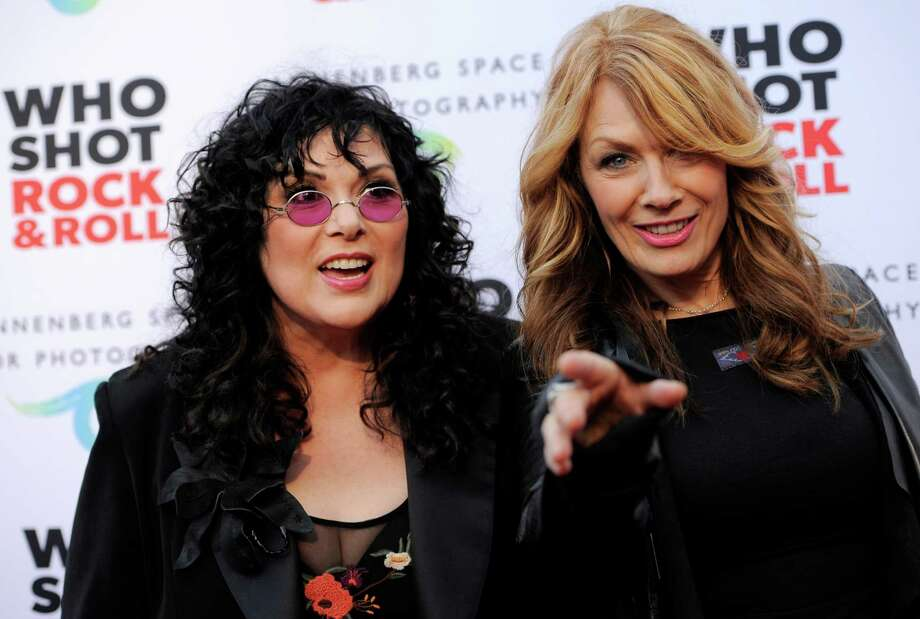 "Ann Wilson, left, and her sister Nancy Wilson of the band Heart pose together at the ""Who Shot Rock and Roll"" photo exhibition opening at the Annenberg Space for Photography on Thursday June 21, 2012 in Los Angeles. (Photo by Chris Pizzello/Invision/AP) Photo: Chris Pizzello / 2012 Invision"