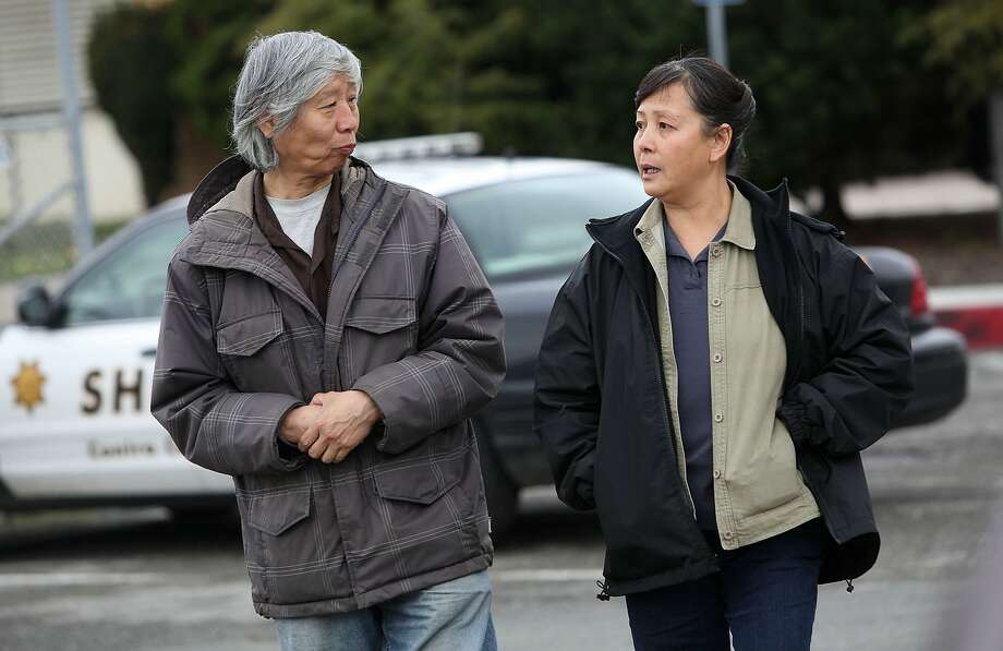The parents of Alice Sin, Wah, left, and Ling Sin, leaving Contra Costa County Superior court in Richmond, Calif.,  on Thursday,  December 6, 2012.  Raymond Wong, accused of murdering their daughter was arrested in 2011, and family and friends are here to attend Wong's hearing. Photo: Liz Hafalia, The Chronicle