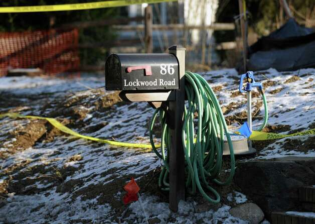 A garden hose draped around the mailbox at 86 Lockwood Road in Riverside, Thursday afternoon, Jan. 3, 2013. Police and fire investigators are trying to figure out how an excavator at the site became fully engulfed in flames late Wednesday night. Photo: Bob Luckey / Greenwich Time