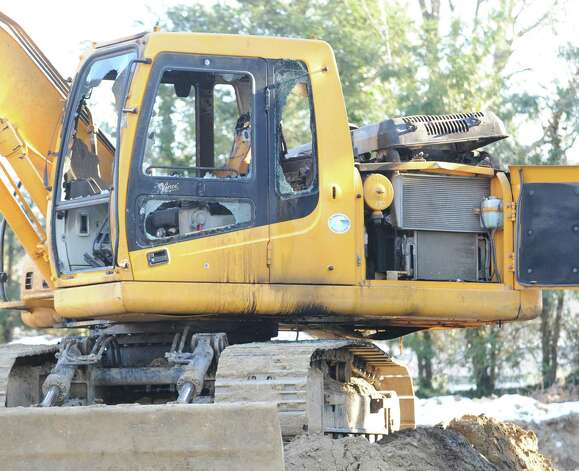 The cab of a fire-damaged excavator at 86 Lockwood Road in Riverside, Thursday afternoon, Jan. 3, 2013. Police and fire investigators are trying to figure out how the excavator caught fire late Wednesday night. Photo: Bob Luckey / Greenwich Time