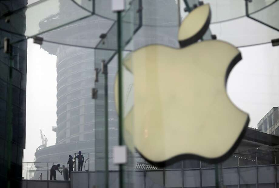 More than 70 percent of Apple's 2012 revenue of $157 billion comes from iPhone and iPad sales. Photo: Eugene Hoshiko, Associated Press