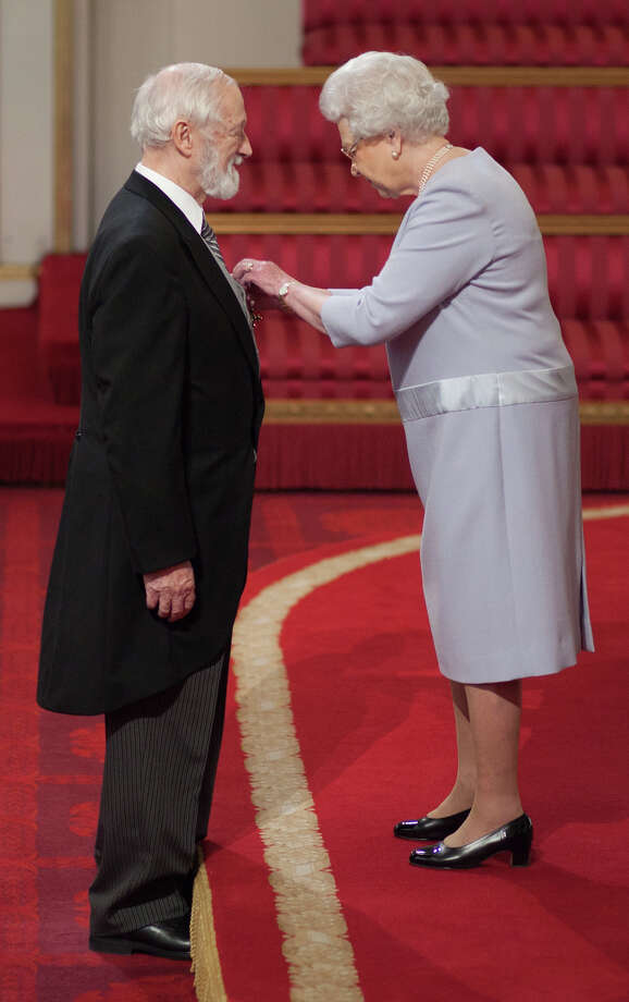 Alan Walton of Westport, a scientist and biotechnology executive, is awarded the Most Excellent Order of the British Empire by Queen Elizabeth II during a ceremony last month at Buckingham Palace. Walton has dual British-U.S. citizenship and was honored for his work in life sciences. Photo: Contributed Photo, British Ceremonial Arts Ltd./Con / Fairfield Citizen contributed