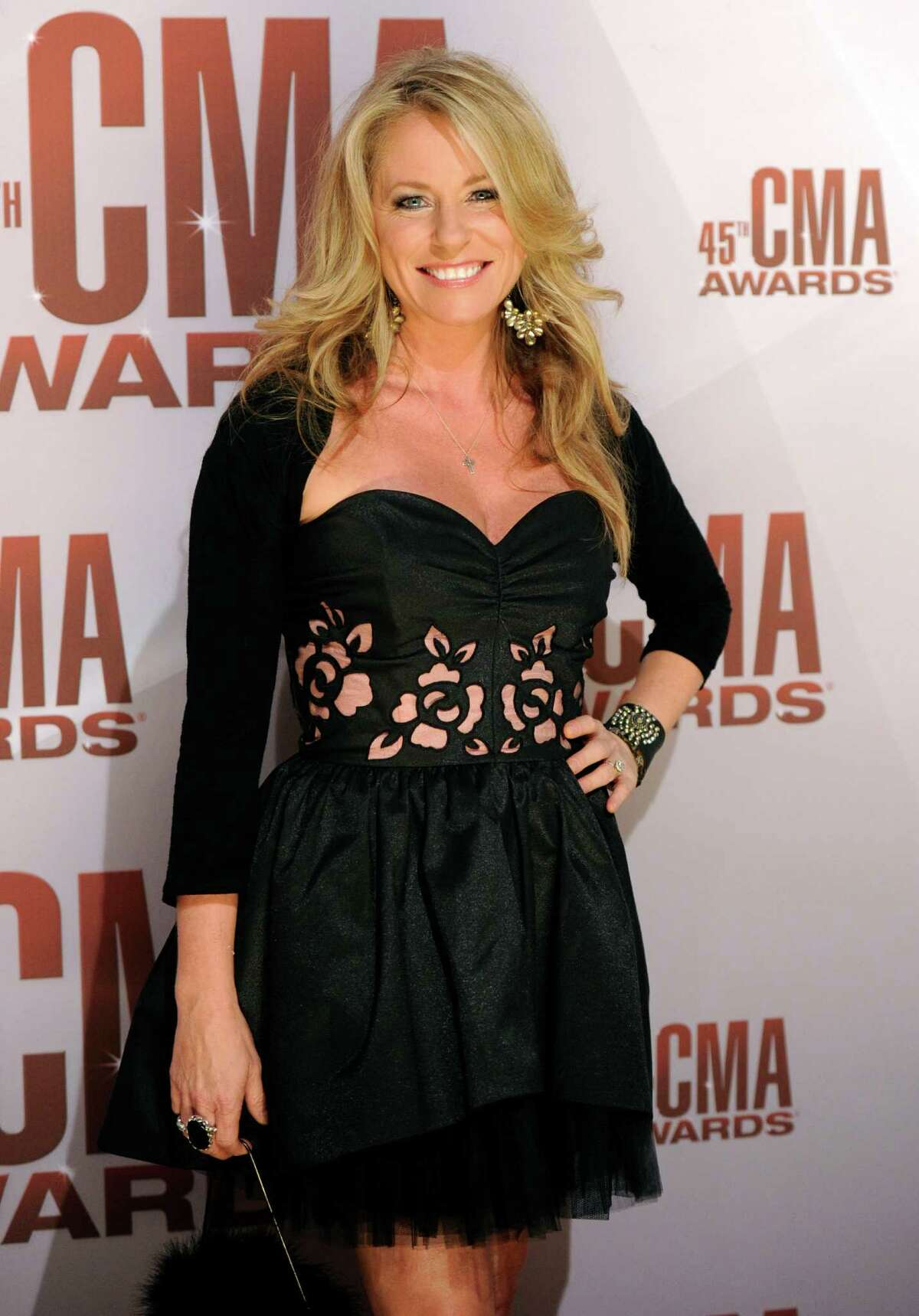 FILE - In this Nov. 9, 2011 file photo, Deana Carter arrives at the 45th Annual CMA Awards in Nashville. Court records show Carter filed for separation from her husband Brandon Malone in Los Angeles on Tuesday, Nov. 13, 2012. The couple were married in October 2009, but separated in August 2011, according to CarterA'A?'s filing citing irreconcilable differences. (AP Photo/Evan Agostini, File)