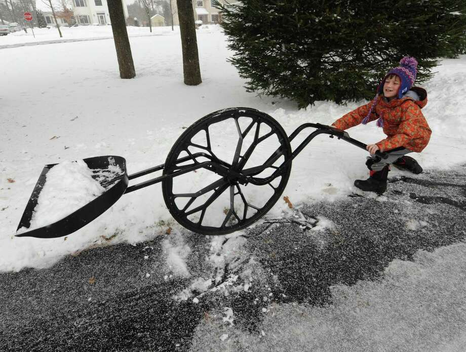 Eight-year-old Brennan Reiner demonstrates a Wovel, a shovel wheel , in Schenectady, N.Y. Saturday Dec. 29, 2012. (Michael P. Farrell/Times Union) Photo: Michael P. Farrell